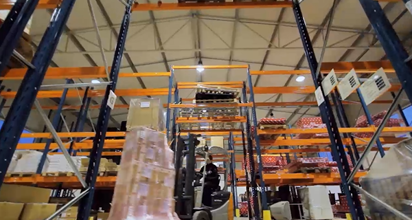 warehouse with worker operating the forklift